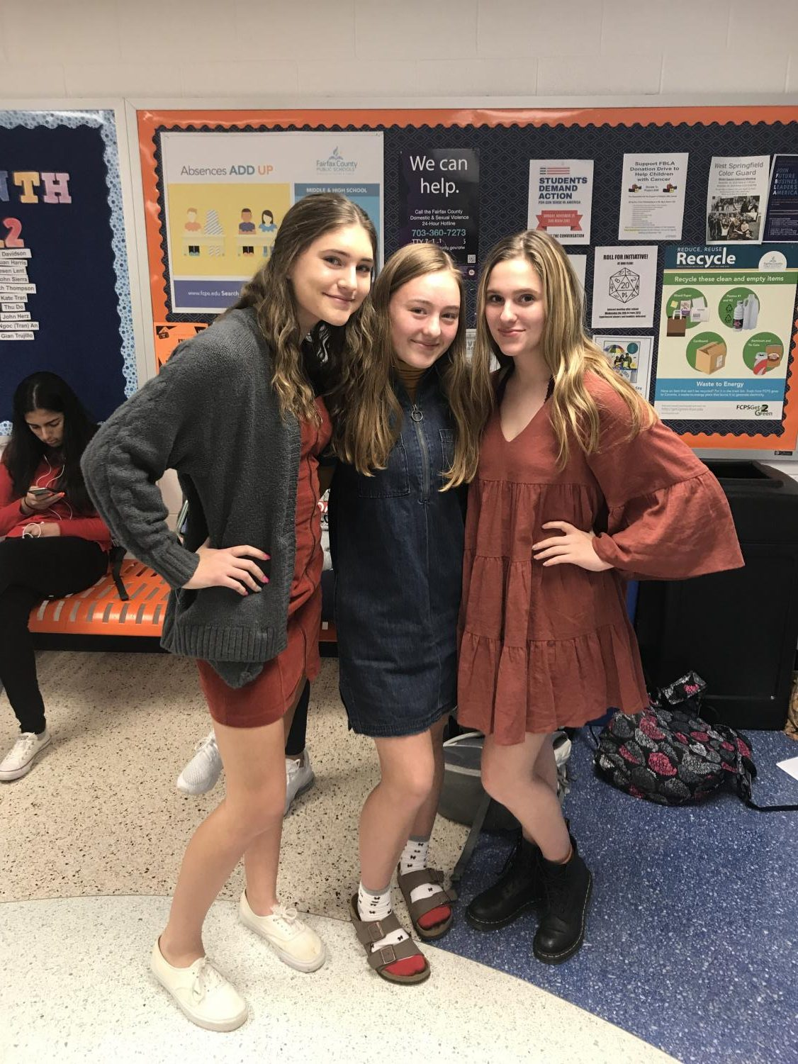 Freshmen Emma Jury, Nora Hennessy, and Helen Phillips wearing dresses to help end human trafficking in society.