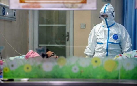 A doctor treating a coronavirus patient in the new Thunder God Mountain Hospital that was constructed in late January for the treatment of the coronavirus. Doctors have to fully cover all skin, as the virus is highly contagious.