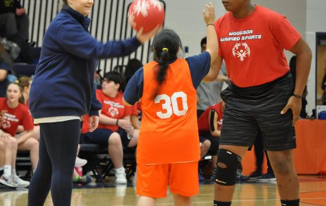Junior Elaine Yepez faces off in a jump ball during the Unified Spartans' first ever Special Olympics event.