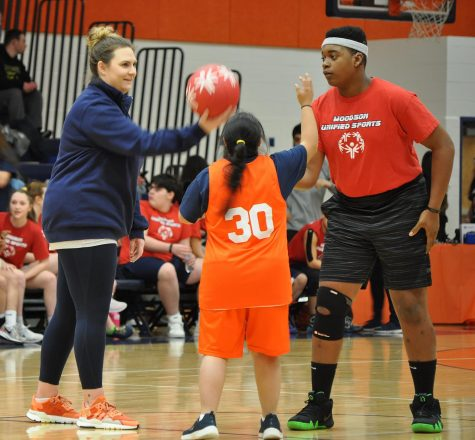 Junior Elaine Yepez faces off in a jump ball during the Unified Spartans