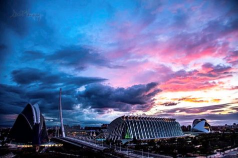 This is a view from the balcony of an apartment in Valencia, Spain. The balcony overlooks the iconic buildings in the City of Arts and Sciences Park. The colors of the sunset showcase the beauty this world has to offer.