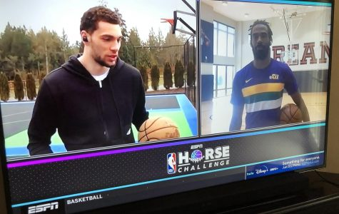 A view of the split TV screen on ESPN as Chicago Bulls forward Zach Lavine explains his next shot in the final round against Utah Jazz guard Mike Conley. Conley would go on to win the competition despite Lavine's use of controversial near-dunks throughout the event.