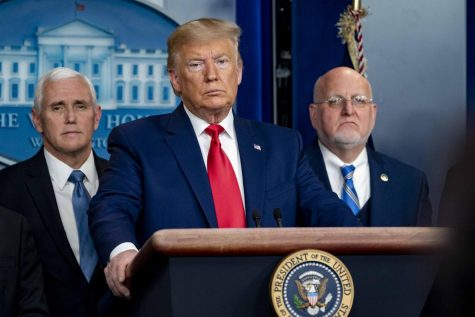 President Trump answering questions at a Coronavirus Task Force press conference on February 29th, 2020. (People Left to Right: VP Mike Pence (R-IN), President Donald Trump (R-FL), CDC Director Dr. Robert Redfield)