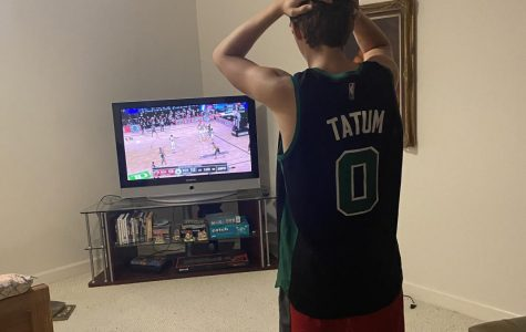 Senior Peter Montavon watches in distress as his beloved Boston Celtics struggle in overtime versus the Miami Heat. Fans of NBA teams making deep playoff runs felt every bit of the tension despite the abnormal circumstances due to the COVID-19 pandemic.