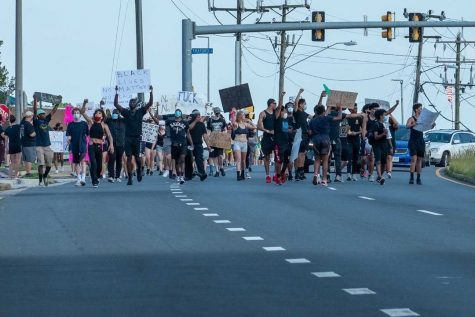 During the June 10th Springfield Solidarity demonstration, protestors march across Rolling Rd and Old Keene Mill Rd. People from WS and the area joined in wearing all black and carrying signs in solidarity.