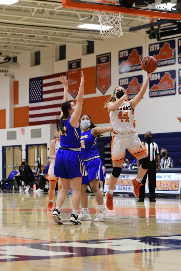 Lexi+White+shooting+during+a+fast+break+at+the+District+Championship.+She+went+on+to+score+14+more+points+throughout+the+rest+of+the+game.+