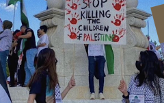 Hundreds of people are seen protesting in Washington D.C. at the Peace Monument in front of the Capitol Building.