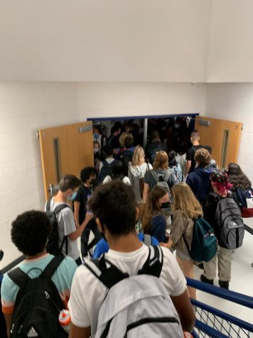Many students crowd stairwell A which demonstrates how the overcrowding within WS is very unsafe for students.
