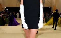 Dixie Damelio, Tik Toker, attended the 2021 Met Gala dressed by designer Valentino. Charli Damelio, her sister, was notably absent from the Met since she doesn't meet the minimum age requirement of eighteen.